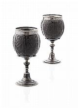 A pair of late 19th century silver mounted coconut cups Height: 18cm