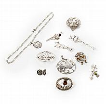 A collection of Scottish silver brooches