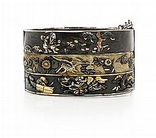 A mid 20th century Japanese silver and bronze hinged bangle Internal width: 68mm