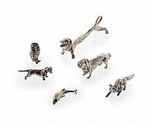 A group of three silver dachshunds