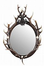 BLACK FOREST STYLE MIRROR 20TH CENTURY, INCORPORATING EARLIER ELEMENTS 68cm wide, 107cm high
