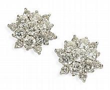 A pair of diamond set cluster earrings Diameter of cluster: 15mm