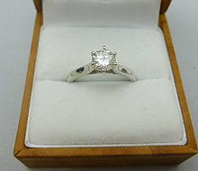A single stone diamond ring Ring size: O, estimated total diamond weight: 0.75cts