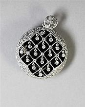 A black enamel and diamond pendant Diameter 30mm