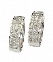 A pair of diamond set earrings 25mm long