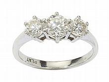 A three stone diamond ring Ring size: O/P