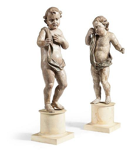 PAIR OF CONTINENTAL CARVED AND POLYCHROMED PUTTI 18TH CENTURY Figure 92cm high