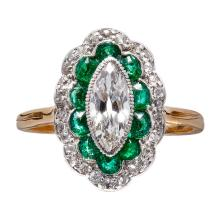 An emerald and diamond set ring Ring size: J, estimated principal diamond weight: 0.54cts