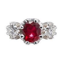 A three stone ruby and diamond set ring Ring size: M/N, estimated total gem weights: ruby 1.57cts, diamonds 1.08cts