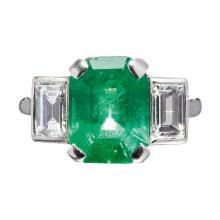 An emerald and diamond set ring Ring size: I, estimated total gem weights: emerald 3.25cts, diamonds 0.96cts