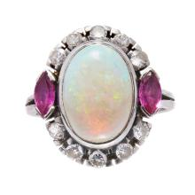 An opal, ruby and diamond set ring Ring size: R