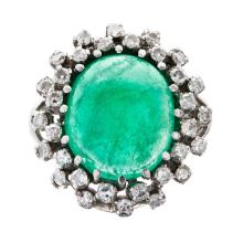 An emerald and diamond set cocktail ring Ring size: K, estimated emerald weight: 8.80cts