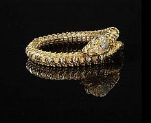 A diamond set snake form bracelet Total weight 80.3g, 24.5cm overall length, 5.8cm inner diameter when closed