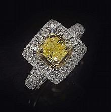 A fancy yellow and colourless diamond set cluster ring Ring size: M/N, cluster 1.2cm x 1.1cm