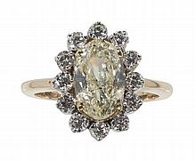 A yellow diamond cluster ring Ring size: N, Principal diamond calculated to be 2.02cts
