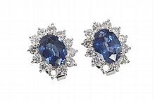 A pair of 18ct white gold mounted sapphire and diamond set earrings 14mm x 11mm, Estimated total weights: sapphires 3.20cts, diamond...