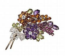 A multi gem set floral spray brooch 7cm high