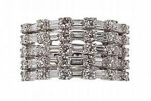 A diamond set cluster ring Ring size: O/P