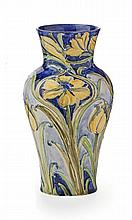 WILLIAM MOORCROFT (1872-1945) FOR JAMES MACINTYRE CO. LTD. 'FLORIAN WARE' BALUSTER VASE, CIRCA 1900 21.3cm high