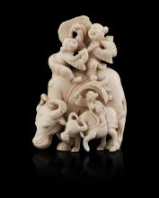 <sup>Y</sup> CARVED IVORY FIGURAL GROUP QING DYNASTY, 19TH CENTURY 7cm high