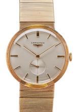LONGINES - A gentleman's 18ct gold cased wrist watch Diam diameter: 28mm