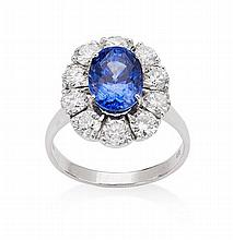 A sapphire and diamond set cluster ring Ring size: M/N, Estimated total sapphire weight: 4.35cts