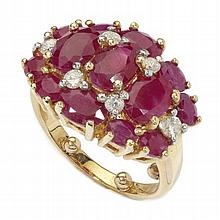 A ruby and diamond cluster ring Ring size: H/I