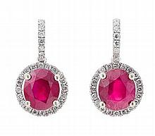 A pair of ruby and diamond set pendant earrings Length of drop: 18mm, Estimated total gem weights: ruby 4.50cts, diamonds 0.42cts