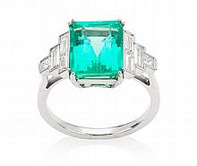 An emerald and diamond set ring Ring size: N/O, Estimated emerald weight: 4.22cts