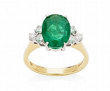 A modern 18ct gold mounted emerald and diamond set ring Ring size: O, Estimated weights: emerald 2.21cts, diamonds 0.36cts total.