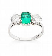 A three stone diamond and emerald set ring Ring size: N/O