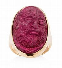 A carved tourmaline cameo ring Ring size: O, Cameo: 27mm long