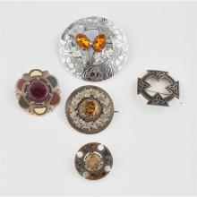 A collection of Scottish brooches
