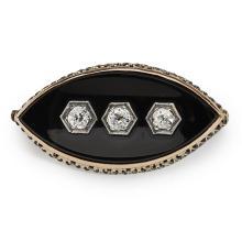 A Victorian diamond and onyx set brooch Length: 33mm