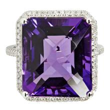 An amethyst and diamond set cocktail ring Ring size: N, estimated total gem weights: amethyst 14.00cts, diamonds 0.45cts