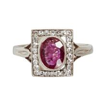 A ruby and diamond set cluster ring Ring size: L/M