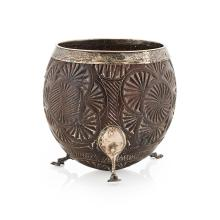 A George III silver mounted half coconut cup Height: 10cm