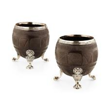 A pair of George III silver mounted coconut cups Height: 12cm