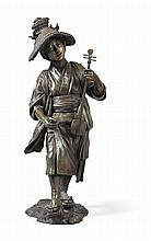 LARGE JAPANESE BRONZE FIGURE OF A TRAVELLING MUSICIAN SIGNED DAI-NIHON TOKYO MORI HOSEI SAKU, LATE MEIJI PERIOD 94cm high