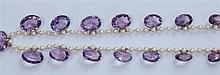 An Edwardian pearl and amethyst set necklace 47cm long