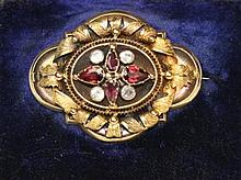 A Victorian gold and gem set brooch Width of brooch: 4cm