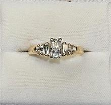 A diamond set ring Ring size: K