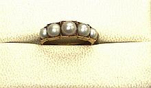 A pearl set ring Ring size: N/O