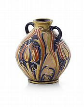 WILLIAM MOORCROFT (1872-1945) FOR JAMES MACINTYRE & CO. MINIATURE 'ALHAMBRA' PATTERN TWIN HANDLED VASE