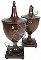 A pair of Regency style mahogany urn tea caddies 33.5cm high
