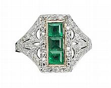 An early 20th century diamond and emerald set ring Ring size: M