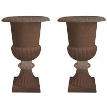 Monumental pair of cast iron urns. H: 49