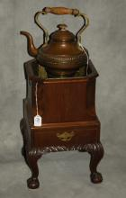 George II mahogany tea kettle stand with brass teapot.