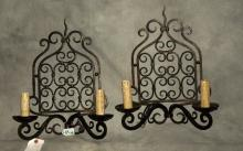 Pair of iron two-light wall sconces. H: 18