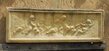 Cast stone putti wall plaque. H: 14